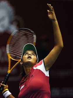 Sania Mirza prepares to serve