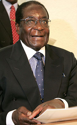 President Robert G. Mugabe of Zimbabwe denounced President Bush and Prime Minister Tony Blair of Britain