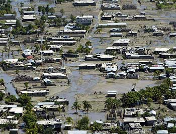 In Gonaïves, health care workers and rescuers from around the world struggled to meet the needs of survivors of the devastating floods unleashed by Tropical Storm Jeanne