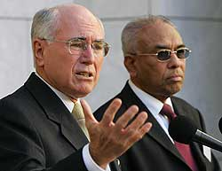 Prime Minister John Howard of Australia (left) and Dr. Ameer Ali, President of the Australian Federation of Islamic Councils